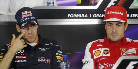 Ferrari Formula One driver Fernando Alonso (R) of Spain and Red Bull driver Sebastian Vettel of Germany attend a news conference ahead of th