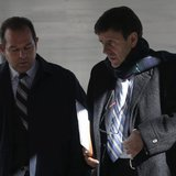 Spanish doctor Eufemiano Fuentes (R) leaves a courthouse on the first day of the high-profile Operacion Puerto doping trial in Madrid, Janua