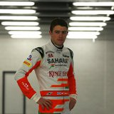 Force India Formula One driver Paul Di Resta of Britain poses for photographers during the launch of the VJM06 car at the Silverstone Race c