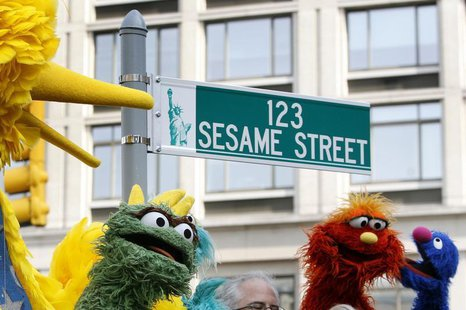 Sesame Street characters are seen during the 40th anniversary street naming celebration in New York, November 9, 2009. REUTERS/Shannon Stapl