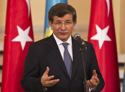 Turkey's Foreign Minister Ahmet Davutoglu speaks during a news briefing with Kazakhstan's Foreign Minister Yerlan Idrisov in Almaty April 26