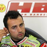 Ducati MotoGP rider Hector Barbera of Spain adjusts his earplugs inside his box during a training session at Circuit de Catalunya, in Montme