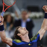 Andy Murray of Britain celebrates his victory over Gilles Simon of France in their men's singles match at the Madrid Open tennis tournament,
