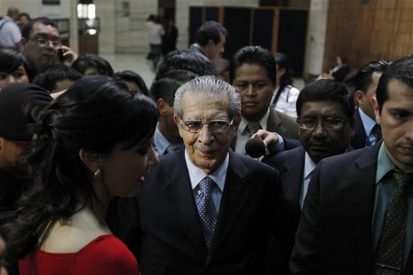 Former Guatemalan dictator Efrain Rios Montt (C) leaves the last session of his genocide trial at the Supreme Court of Justice in Guatemala