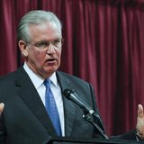 Missouri Governor Jay Nixon participates in a debate with David Spence at the Holiday Inn Executive Center in Columbia, Missouri, September