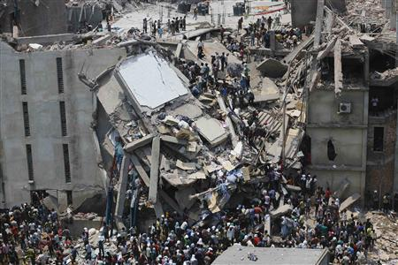 People rescue garment workers trapped under rubble at the Rana Plaza building after it collapsed, in Savar, 30 km (19 miles) outside Dhaka in this April 24, 2013 file photo.  Credit: REUTERS/Andrew Biraj