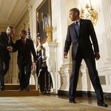 U.S. President Barack Obama walks away from the podium after announcing Democratic Representative Mel Watt (C) as his nominee for director o