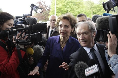 French Social Affairs and Health Minister Marisol Touraine (C) arrives at Roger Salengro hospital in Lille, May 11, 2013, where the patient