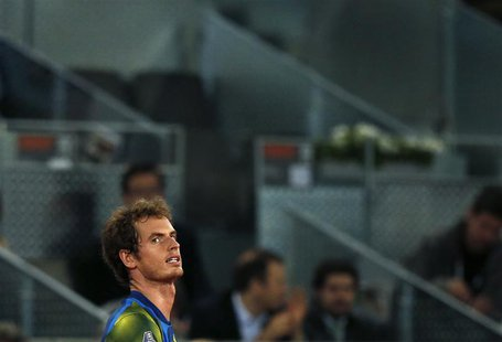 Andy Murray of Britain reacts during his men's singles quarterfinal match against Tomas Berdych of the Czech Republic at the Madrid Open ten