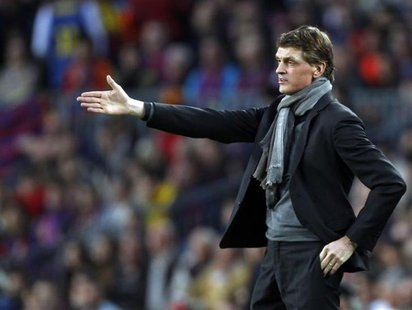 Barcelona's coach Tito Vilanova gestures during the Champions League semi-final second leg soccer match against Bayern Munich at Camp Nou st