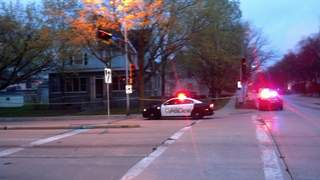 Green Bay Police squad cars seen near the scene of a suspicious death on May 11, 2013. (courtesy of FOX 11).