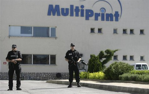 Bulgarian police stand guard outside a printing house in the town of Kostinbrod, near Sofia May 11, 2013. REUTERS/Lyubomir Spirov/BGNES