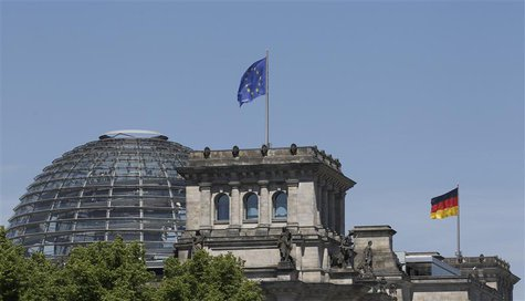 The EU and the German national flag are set up atop the Reichstag building, seat of the German lower house of parliament Bundestag in Berlin