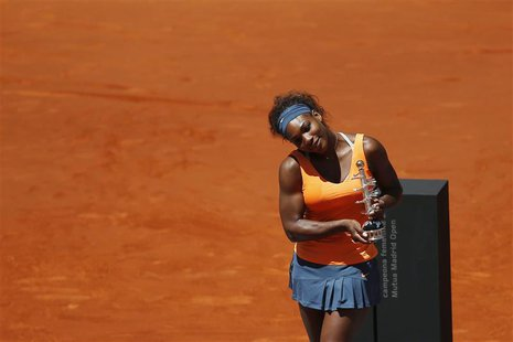Serena Williams of the U.S. poses with the Ion Tiriac's trophy after winning the Madrid Open final tennis match against Maria Sharapova of R