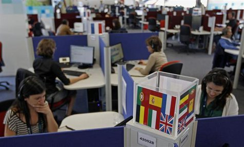 People work at a call center in Lisbon April 22, 2013. REUTERS/Jose Manuel Ribeiro