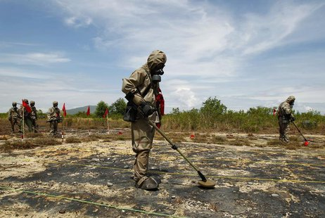 "Soldiers detect Unexploded Ordnance (UXO) and defoliant Agent Orange during the launch of the ""environmental remediation of dioxin contamina"
