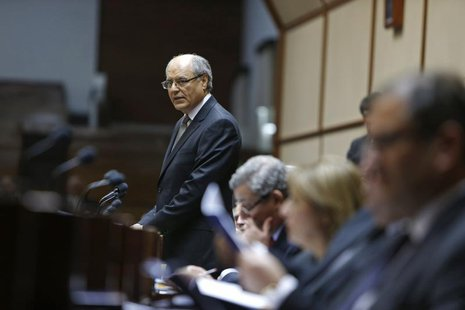 Malta's Finance Minister Edward Scicluna presents the 2013 Budget speech in parliament in Valletta April 8, 2013. REUTERS/Darrin Zammit Lupi