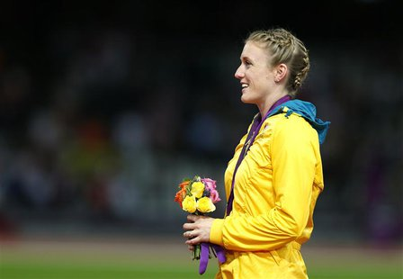 Australia's Sally Pearson stands on the podium after being presented with the gold medal for the women's 100m hurdles at the London 2012 Oly