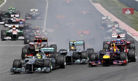 Mercedes Formula One driver Nico Rosberg of Germany (bottom L) leads going into the first curve in the first lap during the Spanish F1 Grand
