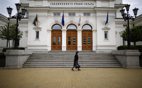 A woman walks past the parliament building in Sofia May 13, 2013. REUTERS/Stoyan Nenov