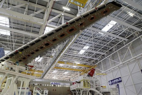 A wing and main body section of the first Airbus A350 is seen on the final assembly line in Toulouse, southwestern France, October 23,2012.