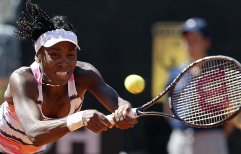 Venus Williams of the U.S. hits a return to Laura Robson of Britain during their women's singles match at the Rome Masters tennis tournament