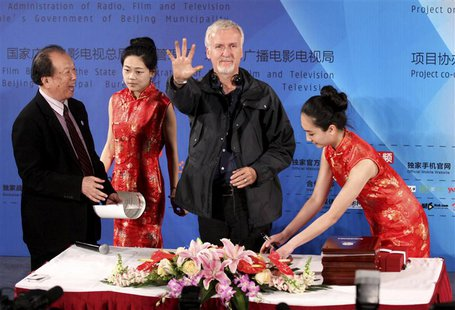 Canadian film director James Cameron shows his palm after making a handprint following a seminar on 3D technology and film cooperation durin