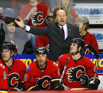 Calgary Flames coach Mike Keenan yells at the referee during the third period of Game 3 in their NHL Western Conference quarterfinal hockey