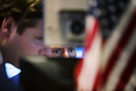 A trader looks at his screen on the floor of the New York Stock Exchange May 8, 2013. REUTERS/Lucas Jackson