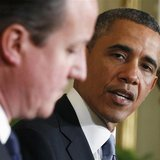 U.S. President Barack Obama (R) looks toward Britain's Prime Minister David Cameron (L) during a joint news conference in the East Room of t