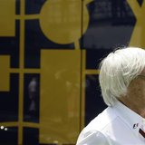 Formula One supremo Bernie Ecclestone looks on at a paddock before the qualifying session at the Spanish F1 Grand Prix at the Circuit de Cat