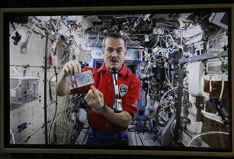 Canadian Space Agency astronaut Chris Hadfield, the commander of the International Space Station (ISS), is seen on a screen holding the new
