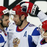 Russia's Ilya Kovalchuk (C) celebrates his goal against Austria with teammates Alexander Radulov (L) and Alexei Tereshenko during their 2013