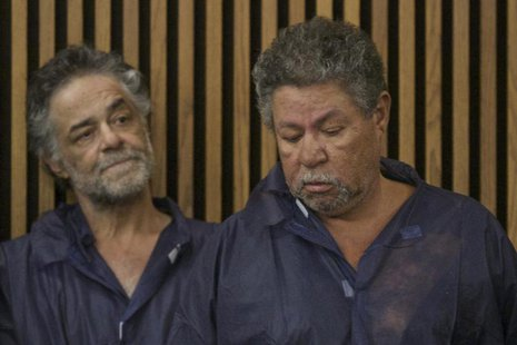 Onil Castro and Pedro Castro (R) appear for their initial court appearance in Cleveland, Ohio, May 9, 2013. REUTERS/John Gress