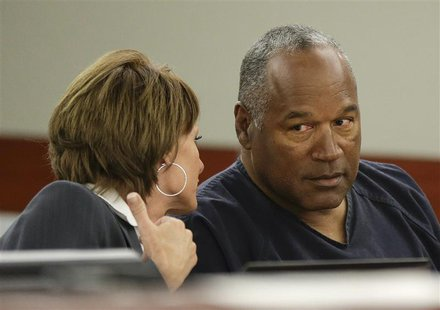 O.J. Simpson (R) sits with his attorney, Patricia Palm in Clark County District Court during his evidentiary hearing in Las Vegas, Nevada Ma