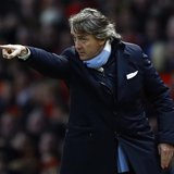 Manchester City's coach Roberto Mancini gestures during their English Premier League soccer match against Manchester United in Manchester, n