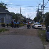 New Orleans Police Department members are seen at the site of a shooting of at least 12 people during a Mother's Day parade in New Orleans, Louisiana, May 12, 2013, as pictured in this photo provided by Fox 8 News. At least 12 people were shot at the parade in New Orleans, with one victim as young as 10 years old, WWLTV reported, citing police Superintendent Ronal Serpas. (Reuters)