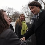 Canadian Liberal leader Justin Trudeau shakes the hand of a pedestrian after a news conference outside of the National Assembly in Quebec Ci