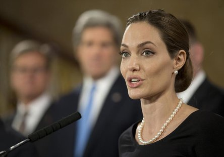 Actress and humanitarian campaigner Angelina Jolie speaks at a news conference on sexual violence against women during the G8 Foreign Minist
