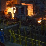 A worker stands in front of a rolling mill in the ArcelorMittal steel factory in Eisenhuettenstadt, 124 km (77 miles) east of Berlin Novembe
