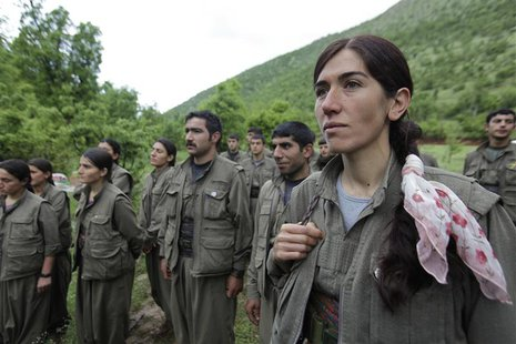 Kurdistan Workers Party (PKK) fighters stand at formation in northern Iraq May 14, 2013. REUTERS/Azad Lashkari