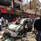 People gather at the scene of a car bomb explosion outside a hospital in Benghazi May 13, 2013. REUTERS/Esam Al-Fetori