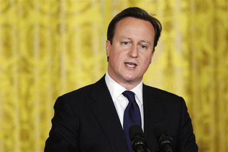 Britain's Prime Minister David Cameron responds to a question during a joint news conference with U.S. President Barack Obama in the East Ro