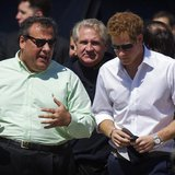 Britain's Prince Harry (R) walks with New Jersey Governor Chris Christie as they view areas of the boardwalk that have been repaired in Seas