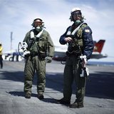 Northrop Grumman test pilots Bruce McFadden (L) and Dave Lorenz are pictured with their arm-mounted controllers after they successfully laun