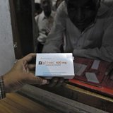 A man buys cancer drug Glivec for a relative who is suffering from cancer at a pharmacy in a government-run hospital in the western Indian c