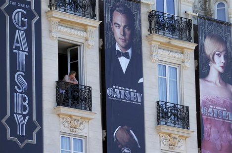 Posters for the film 'The Great Gatsby' showing actor Leonardo DiCaprio (C) and actress Carey Mulligan (R) are displayed outside the Carlton