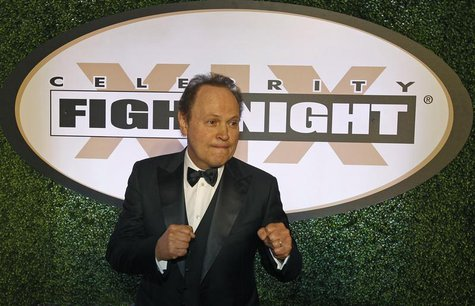 Actor, comedian Billy Crystal arrives on the red carpet at the Muhammad Ali Celebrity Fight Night Awards XIX in Phoenix, Arizona March 23, 2