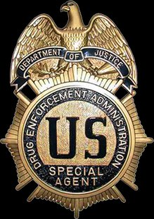 DEA Badge (courtesy of Wikimedia Commons).