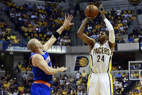 Indiana Pacers forward Paul George (24) shoots the ball as New York Knicks guard Jason Kidd defends during the first half of an NBA Eastern